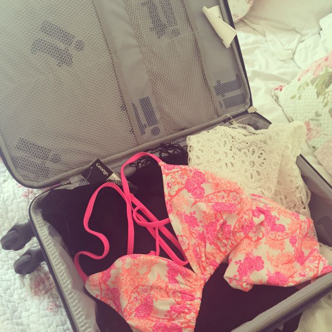 A suitcase filled with George Swimwear goodies!